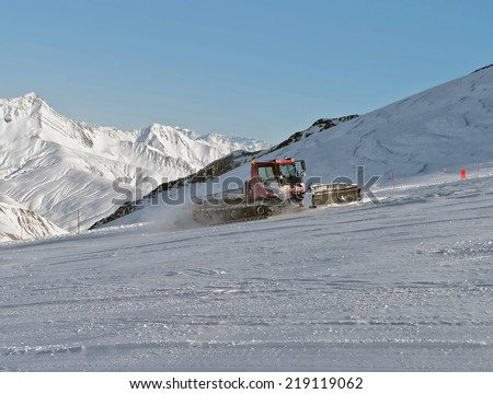 Alpine skiing track preparation - Les Deux Alps, France - stock photo