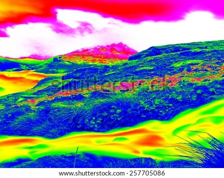 Alpine spring mountain stream  in infrared photo. Hilly landscape in background. Sunny weather with clear sky above. Amazing thermography colors - stock photo