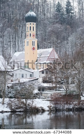 Alpine winter scene with snow covered church