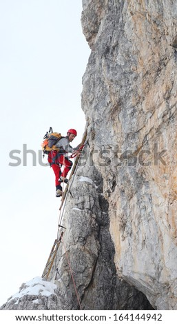 Alpinist climbing ferrata La torre di Toblin (2.617 m), Dolomites, Italy, Europe - stock photo