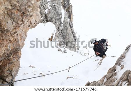 Alpinist climbing ferrata La torre di Toblin (2.617 m), Dolomites, Italy, Europe - stock photo