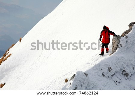 Alpinist descending an icy slope