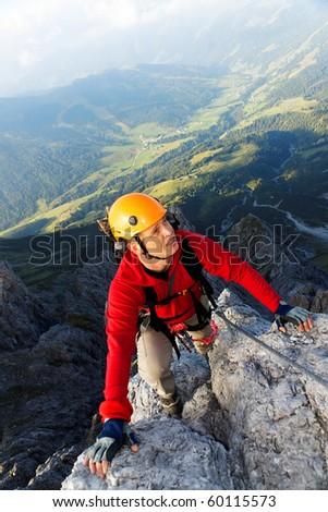 Alpinist on Koenigsjodler route, Austria - stock photo