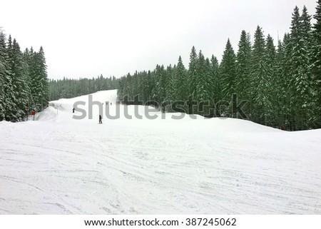 Alpinists on a piste - stock photo