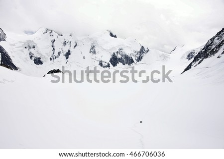 Alpinists traversing Mensu Glacier in Altai Mountains, Russian Federation