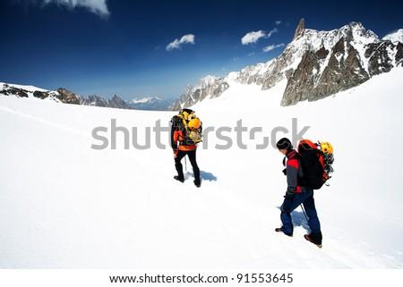 Alpinists traversing Mer de Glace, Haute Savoie, France - stock photo
