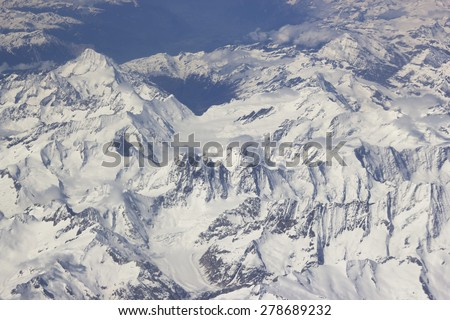 Alps - aerial view from window of airplane - stock photo