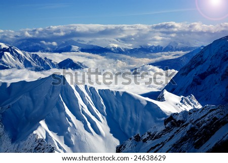 Alps in the winter time. Ski area about Zugspitze peak in Germany and Austria