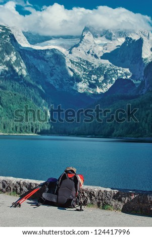 Alps mountain landscape. Hiking equipment on foreground.