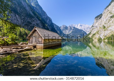 Alps mountains and lake Obersee in Summer with haze in the background, Konigsee National Park, Bayern, Germany