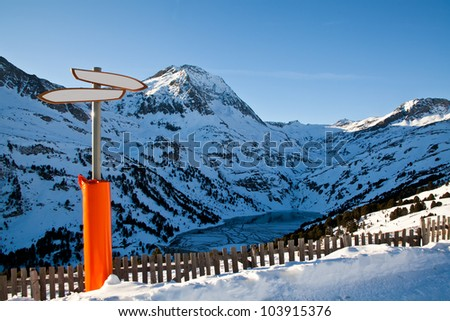 Alps mountains with a pointer to the foreground - stock photo
