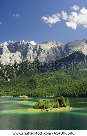 alps mountains Zugspitze and lake Eibsee in Bavaria - stock photo