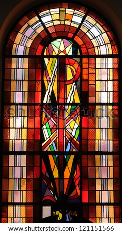 Alsace, stained glass window of the church of  Turckheim in Haut Rhin - stock photo