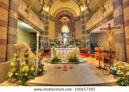 Altar and wooden crucifix in Madonna Moretta catholic church in Alba, Northern Italy. - stock photo