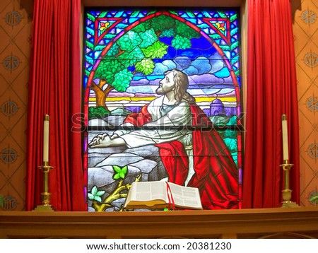 altar bible in front of stained glass window - stock photo