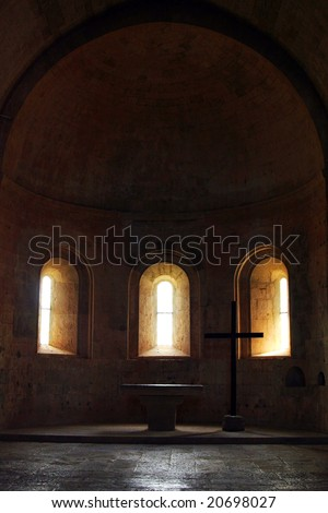 Altar of a middle aged church - stock photo