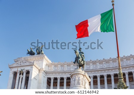 "Altar of the Fatherland (Altare della Patria) known as the Monumento Nazionale a Vittorio Emanuele II (""National Monument to Victor Emmanuel II"") or Il Vittoriano in Rome, Italy. Flag of Italy."