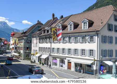 Altdorf, Switzerland - 7 august 2016: people walking in front of old houses at Altdorf in the Canton of Uri, Switzerland