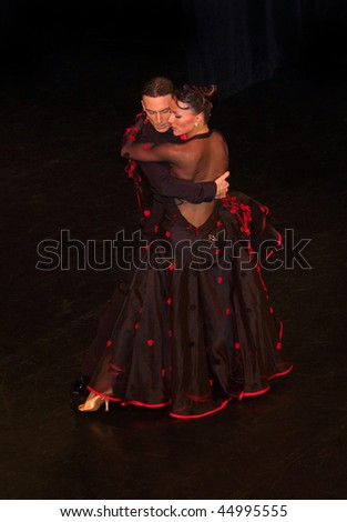 ALTENBURG - DECEMBER 27: Couple Benedetto Ferruggia and Claudia Köhler dance to the Christmas-ball on December 27, 2009 in Altenburg, Thuringia, Germany. - stock photo