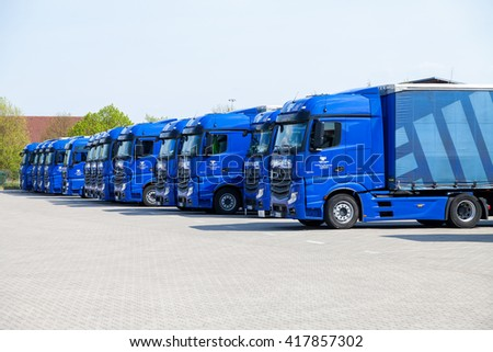 ALTENTREPTOW / GERMANY - MAY 5: merceds benz trucks from haulage firm gertner, stands on logistic depot in altentreptow / germany on may 5, 2016. - stock photo