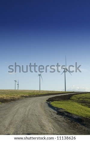 Alternate energy wind generators at the end of a dirt road