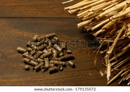 alternative biofuel from straw combustion in furnaces - stock photo