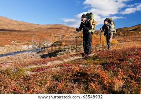 alternative couple on a trekking tour in Lapland - stock photo