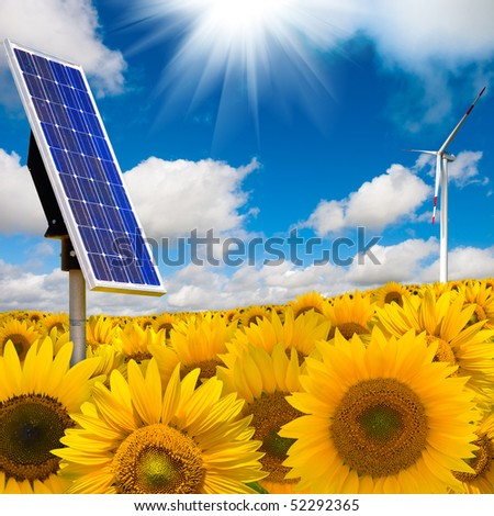 Alternative energy concept with solar panel and wind turbine - stock photo