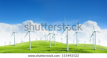 Alternative energy.  Group of energy-producing windmills agains blue sky - stock photo