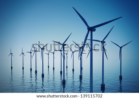 Alternative energy- shot of floating wind turbine farm during foggy day. - stock photo