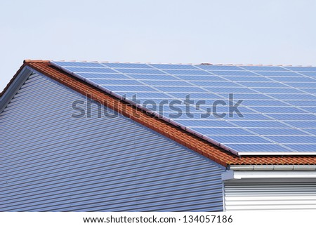 Alternative energy with photovoltaic panels on the roof - stock photo