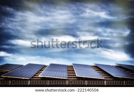 Alternative energy with solar panel system on house roof top - stock photo