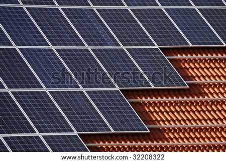 Alternative energy with solar panels - stock photo