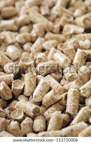 Alternative fuel. Wood pellets made from industrial wood waste. - stock photo