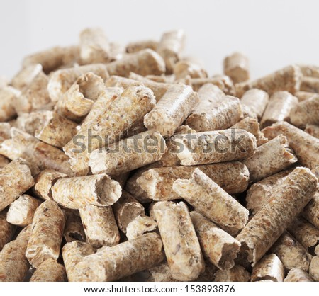 Alternative fuel: Wood pellets made of sawmill waste. - stock photo