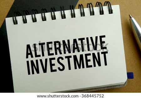 Alternative investment memo written on a notebook with pen