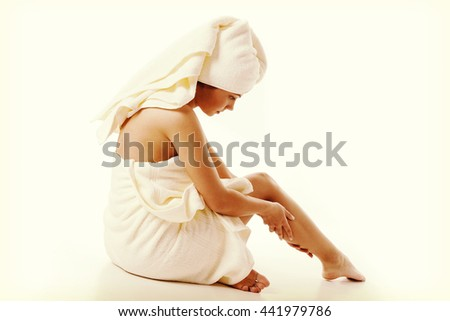 Alternative medicine and body treatment concept. Attractive  young woman after shower with towel. Instagram style - stock photo