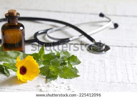 Alternative medicine herbs and stethoscope concept - stock photo