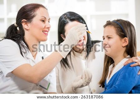 Alternative Medicine - Homeopathy.Young woman and her daughter at the doctor homeopaths.  Treatment with herbs - stock photo