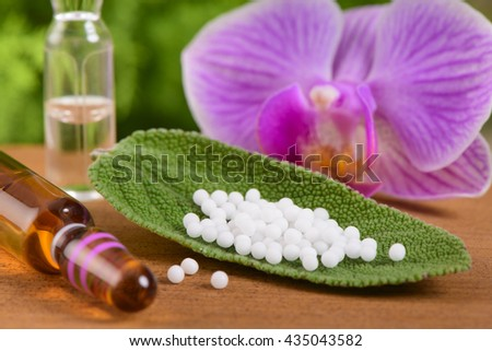 alternative medicine with herbal pills - stock photo