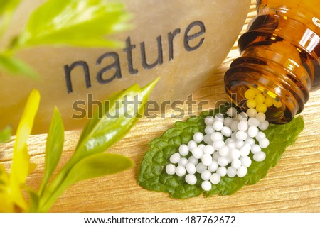 alternative medicine with herbal pills and stone of nature