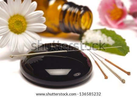 alternative medicine with pills and acupuncture - stock photo