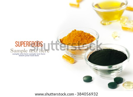 Alternative natural medicine. Dietary supplements. Spirulina, turmeric  and organic oil on white background. Superfood, detox or diet concept - stock photo
