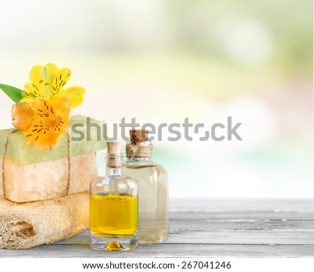Alternative. Spa still life with soap,sponge and cosmetic oil isolated on white background. - stock photo