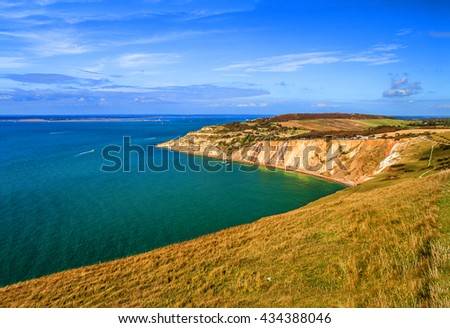 Alum Bay at with beautiful beach and colourful rocks next to the Needles in Isle of Wight in England, United Kingdom - stock photo