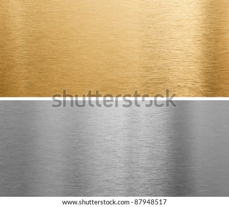 aluminium and brass metal plates background - stock photo