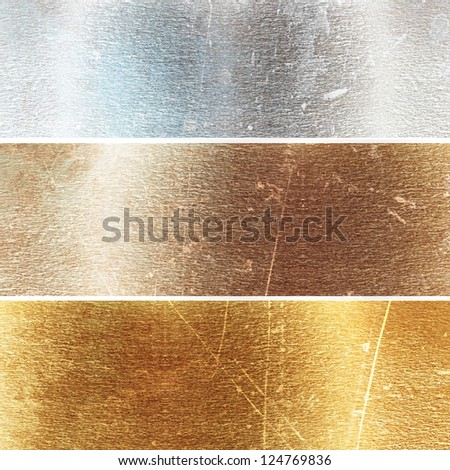 Aluminium, brass and golden plates with some reflected lights and reflections - stock photo