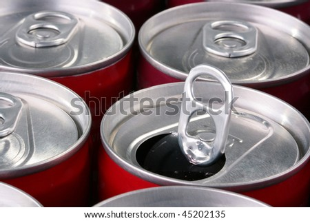 Aluminium containers for soda water, beer or the juice, one bank it is opened. - stock photo