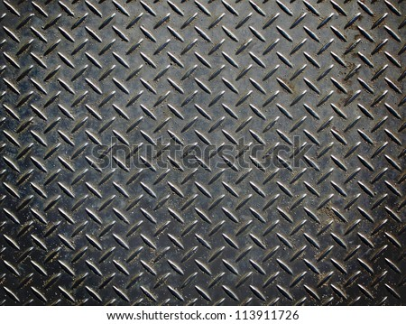 Aluminium dark list with rhombus shapes - stock photo