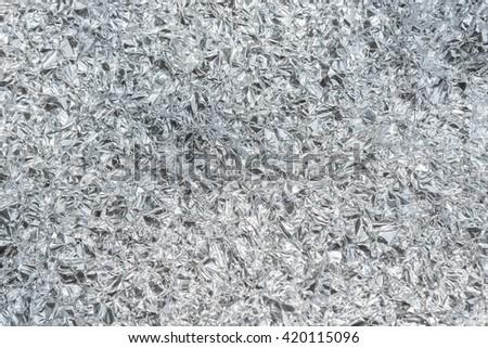 Aluminium foil texture - stock photo